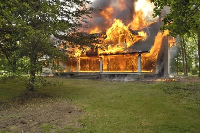 House engulfed in flames requiring fire damage restoration