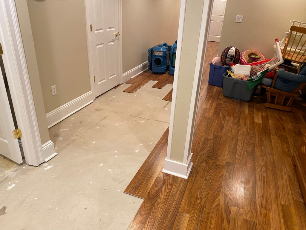 Water damage occurring due to backflow of sewage in the basement